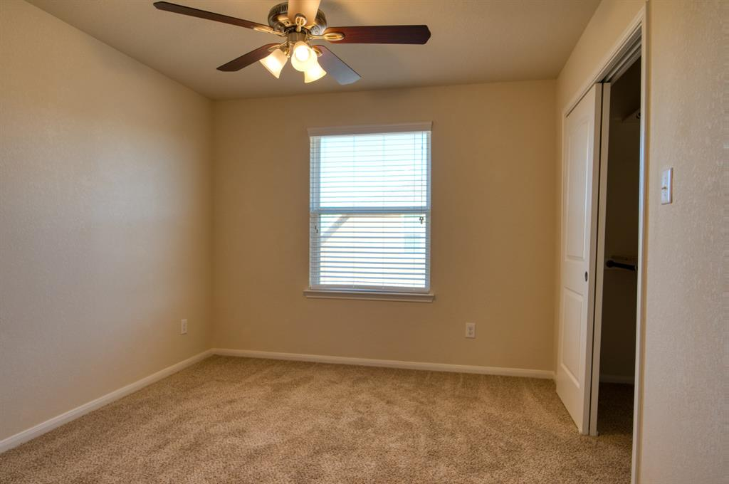 Bedroom #4 Upstairs includes a Ceiling Fan, perfect size for a Guest Room or Craft Room.