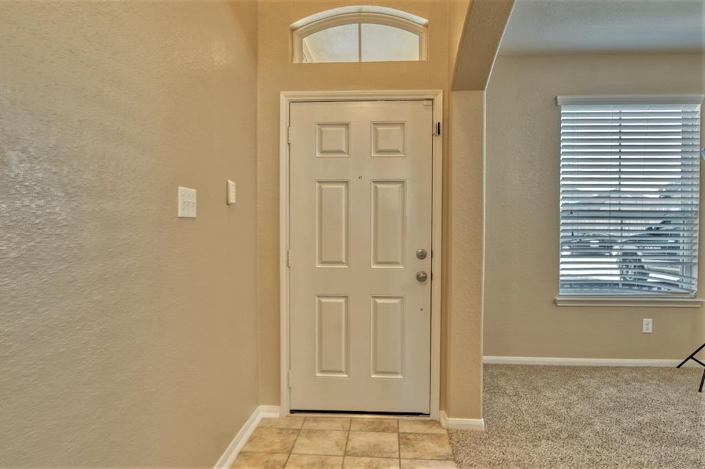 Front Entry to welcome your Guests.  Large Formal Dining or Formal Living located to the Right in this photo.