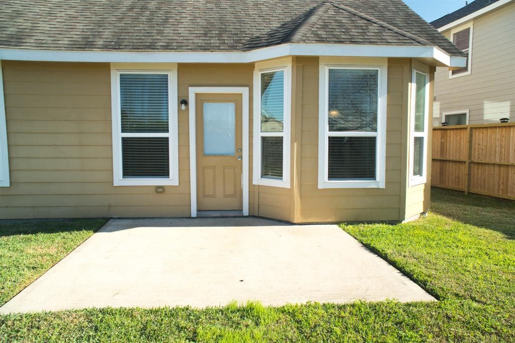 Large Back Patio right off the Kitchen.  Great place for the BBQ & an Outdoor Table!