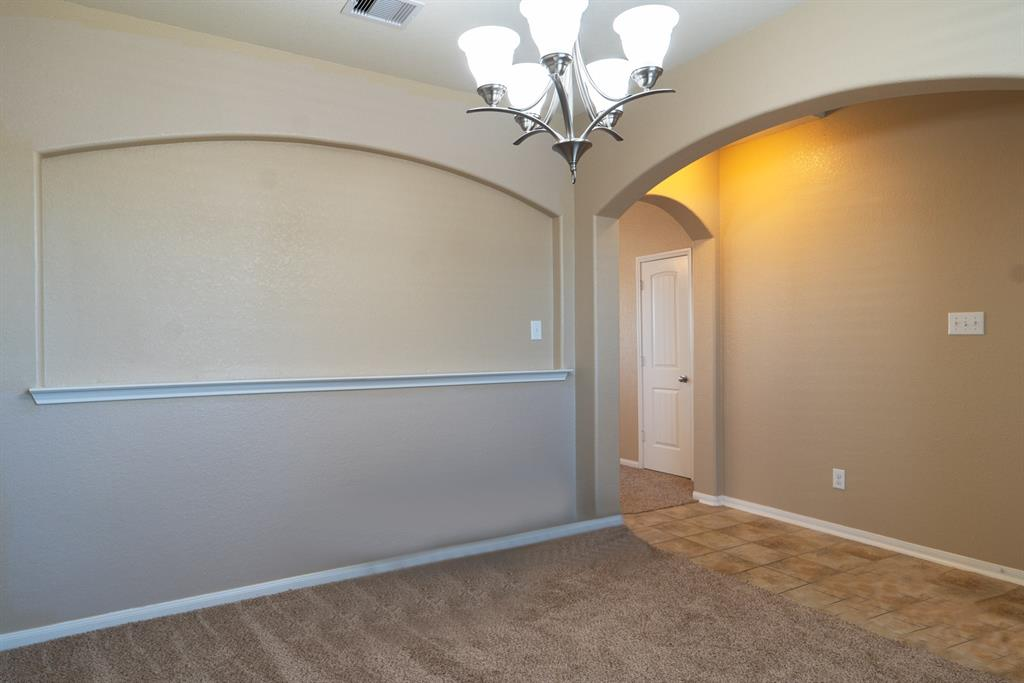 Front Room nearest the Entry is flexible, tucked away space that can easily be used at a Formal Dining, Formal Living, Home Office, Game/Pool Room....many possibilities for a New Homeowner!