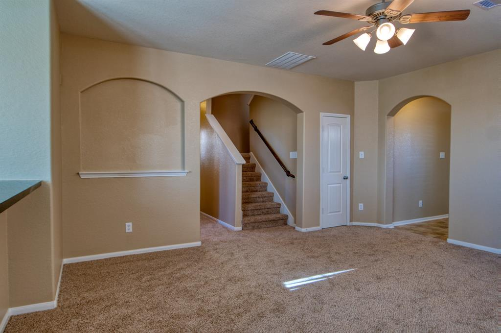 Spacious Family Room is the hub of the Home, centrally located with Open Concept to the Kitchen.  Perfect spot to cozy up and relax after a long day.