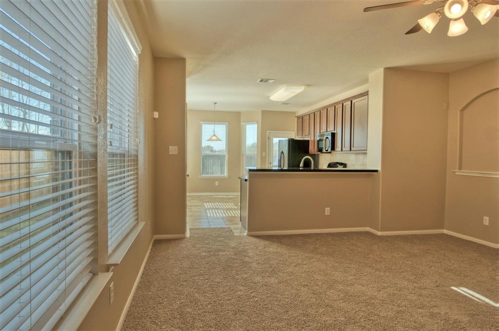 Family Room has a Stylish Niche for Art and a Breakfast Bar into the Kitchen ready for Casual Seating.