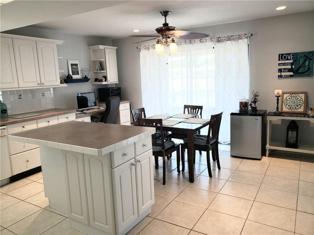 Open and airy kitchen with integrated office nook. Double slider, ceiling fan, recessed lighting.