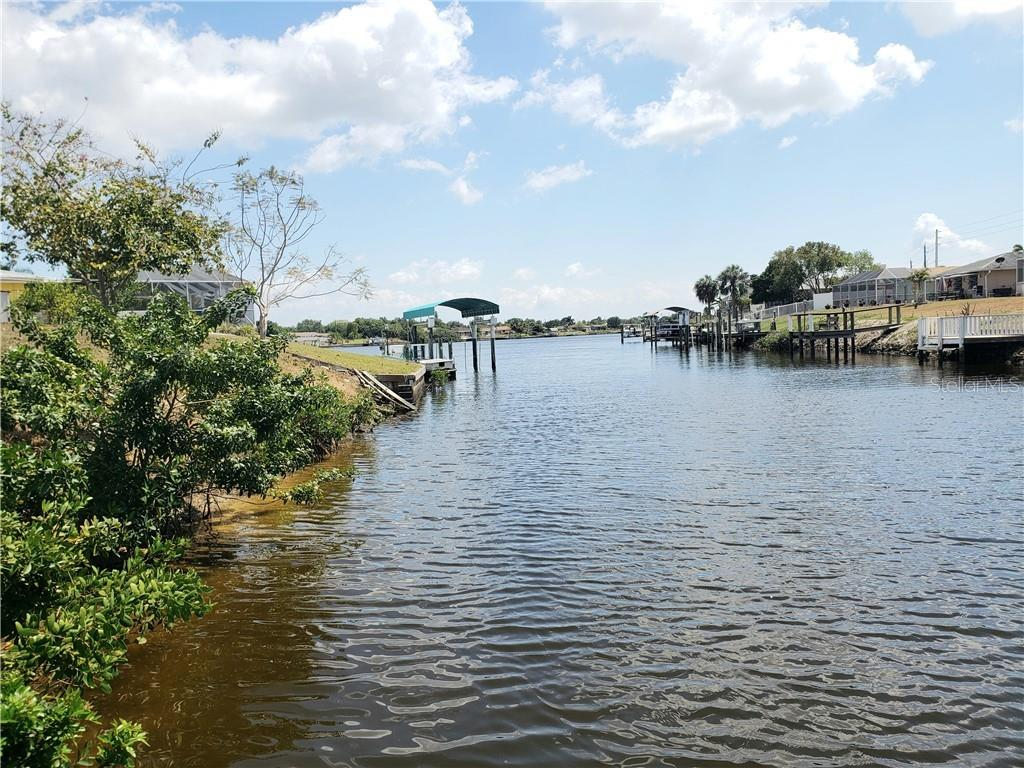Snook or snapper for dinner, anyone?  View of Spring Lake Waterway, two bridges to Charlotte Harbor.