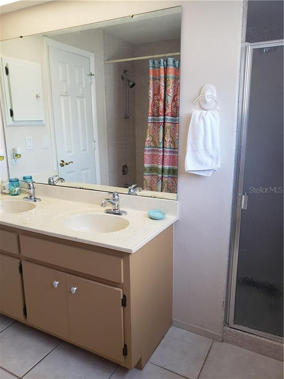 Dual sinks, tub/ shower combo  and walk-in shower.