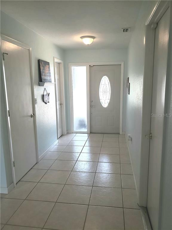 Walk in pantry to the left followed by half bath.  Garage to the right.