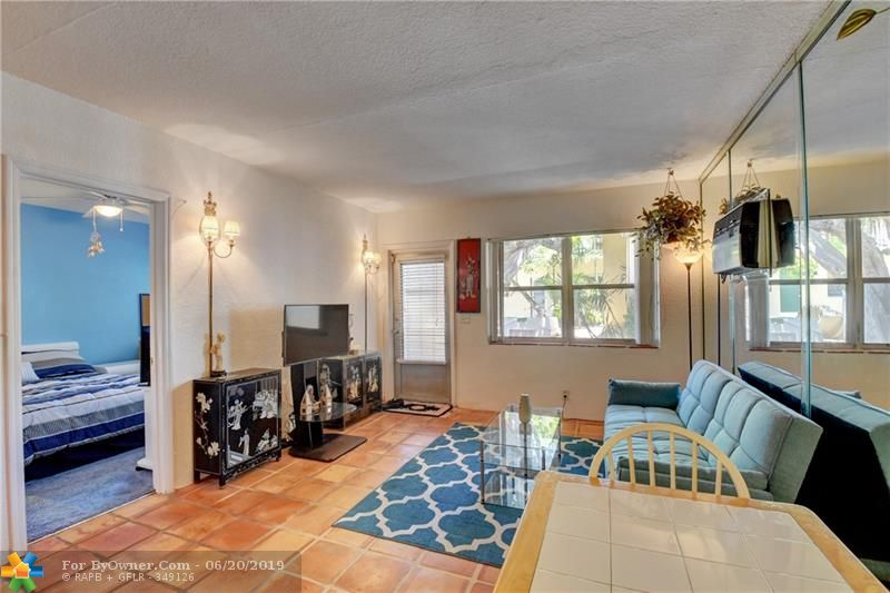 This IS YOUR 1st FLOOR CONDO just outside your door. Check out the BBQ, Bar Set, Outside Dining the Amazing Pool, BBQ, Patio Tables and lots of Lounge Chairs to catch some Warm Florida Sun.