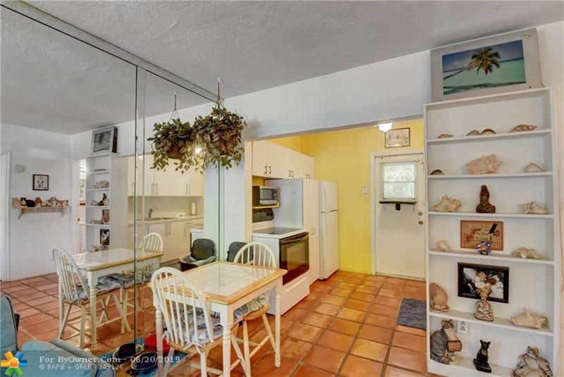1st FLOOR CONDO has 3 Separate Doors to Poolside Patios or your Separate Patio in Back Just Off Your Kitchen. Huge Windows light up your spacious Living Room. 2nd FULL BATH just off your Living Room.