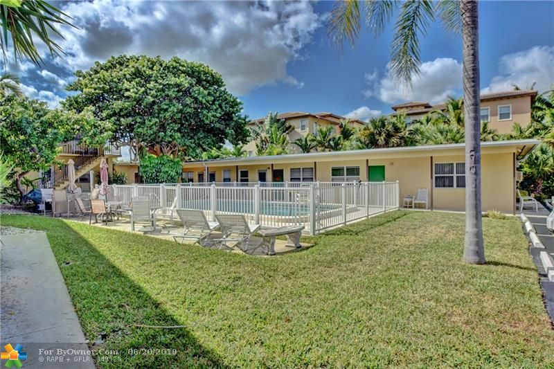 Your Back Patio Area has Easy Access from your Kitchen and your Parking Space. This Back Patio Area is as wide as your entire condo. Perfect when you want to be outside and maybe away from the pool maybe to read or for Romantic Dinner.