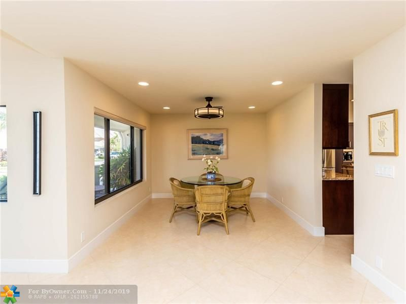 Large great room which runs from front to rear of home with two gathering areas and water views