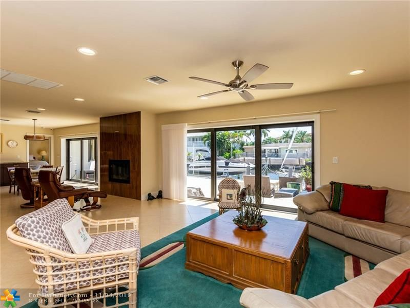 Gathering sliding doors open up both great room and kitchen to indoor outdoor entertaining