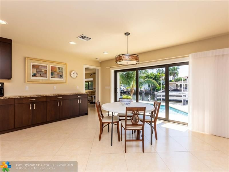Very large kitchen dining area with pool and water views