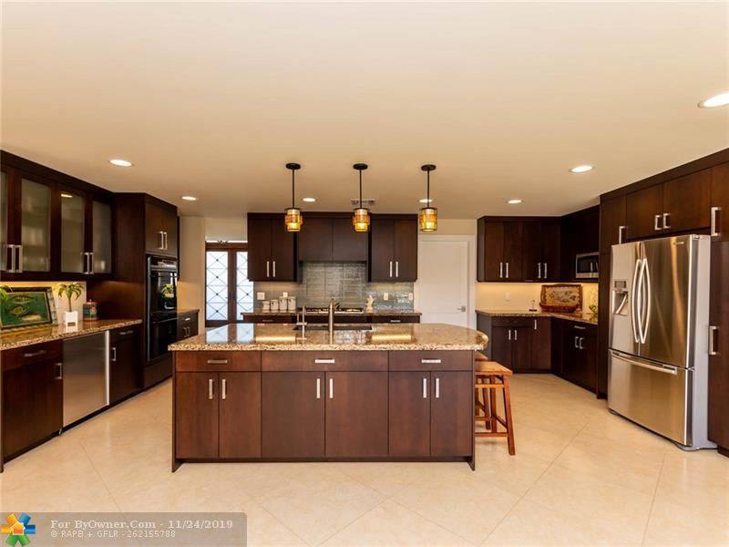 Super sized kitchen is the heart of this home with family and friends in mind