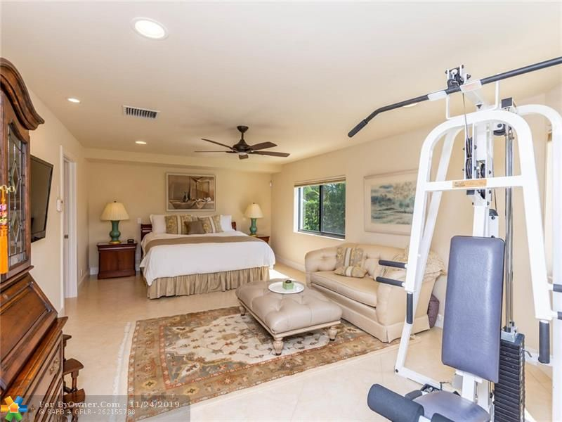 Large master bedroom with pool and canal views