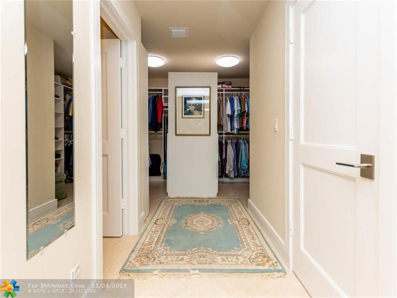 Handy master closet with built ins and dressing areas