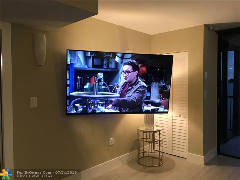 65 Inch High Definition Television on Swivel Mount including Two Sets of 3D glasses.