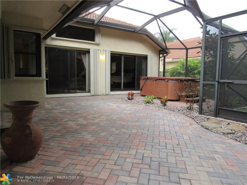 SCREENED PATIO WITH HOT TUB