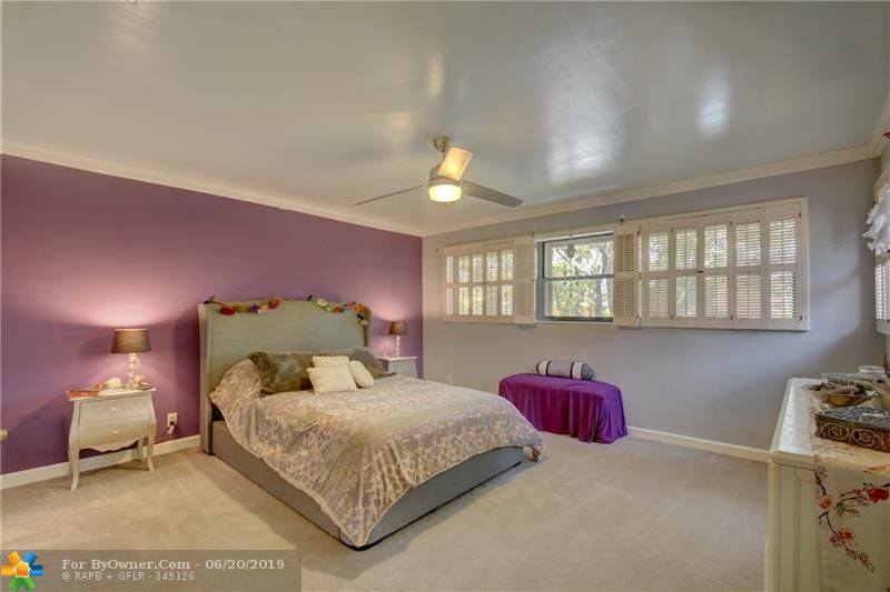 Master bedroom, with peaceful views to the water and trees.