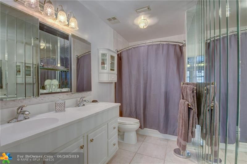 Master bathroom with updated vanity and combination tub and shower.