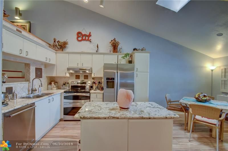 Upgraded stainless appliances for the serious chef, beautiful granite counters and plank laminate floors throughout the ground floor.