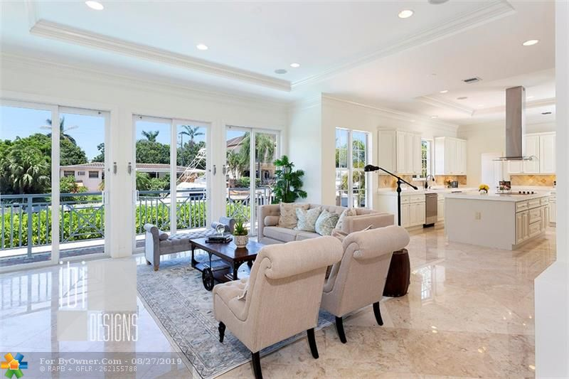 Family Room off the Kitchen with Morning Juice Bar. Approx 10.5 Ft Ceiling Height. Marble Floors.