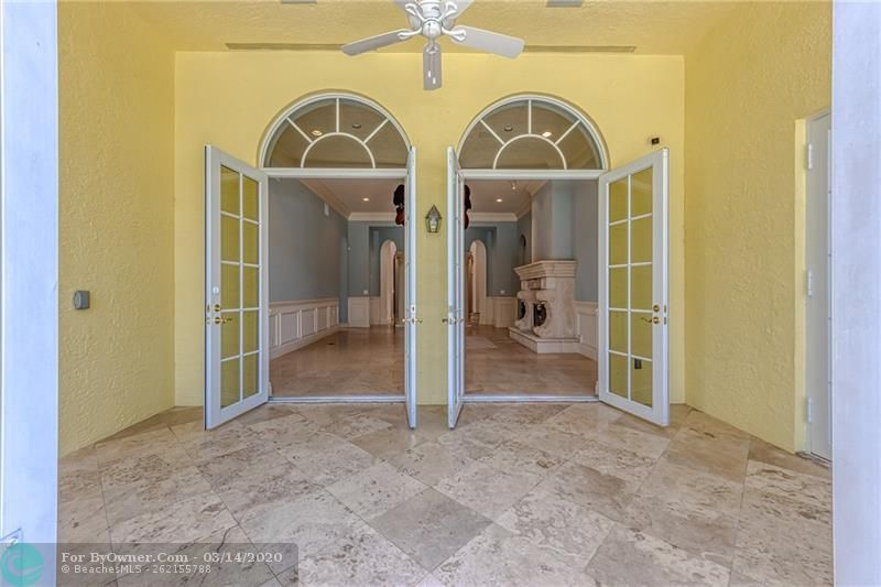 Large covered travertine back porch
