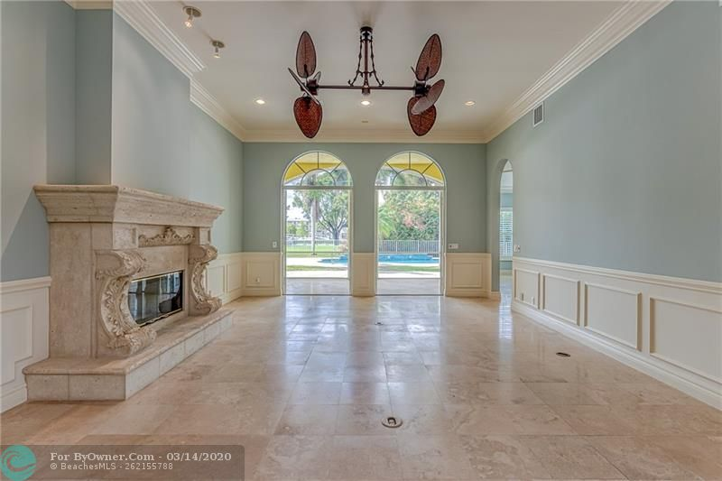 Large living room with 12 ft ceilings and gorgeous stone fireplace and mantle