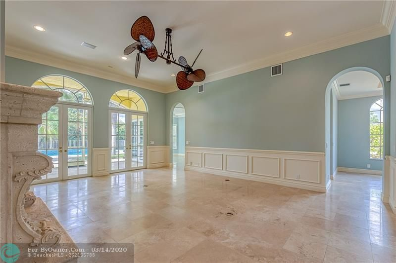 Gorgeous custom trim work in living room with tons of natural light