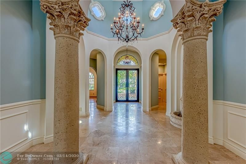Gorgeous front foyer and stone pillars