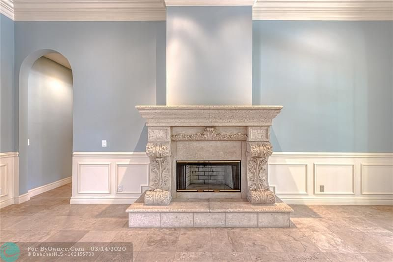Breathtaking fire place and mantle and custom trim work in living room