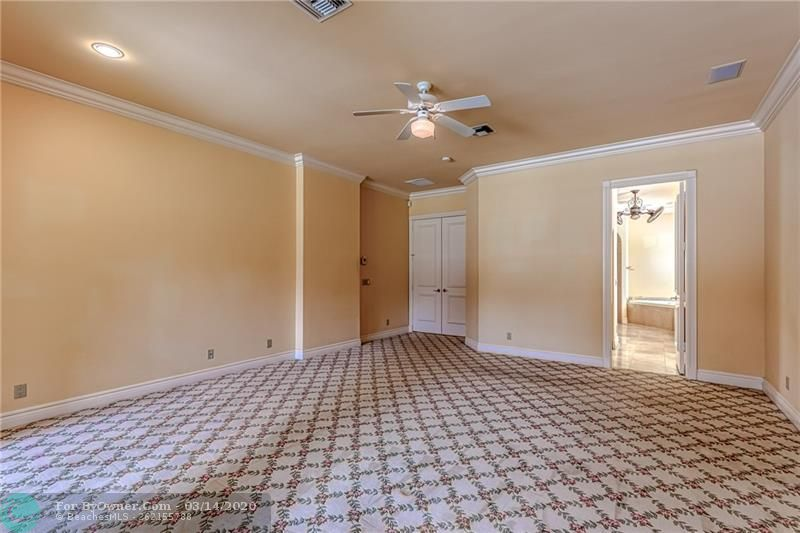 Large master bedroom with carpet
