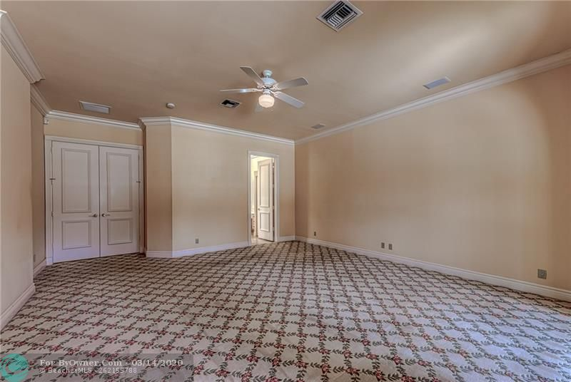 Very large master bedroom with ceiling fan with lighting