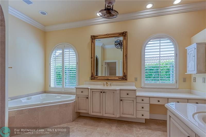 Huge spa tub in master bathroom with tons of natural light