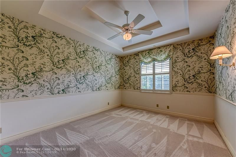 Guest bedroom with carpet and custom wall paper