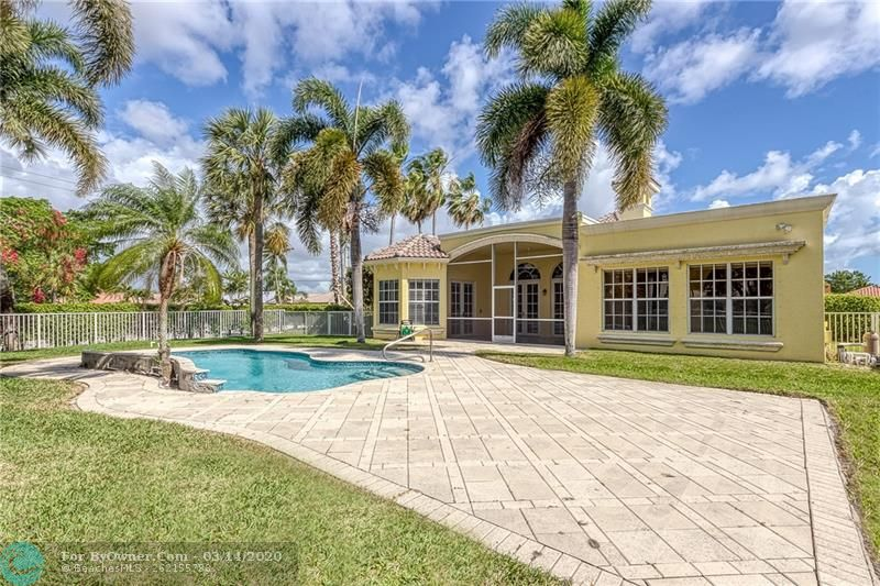 Enjoy this gorgeous backyard with free form pool and large paved sundeck