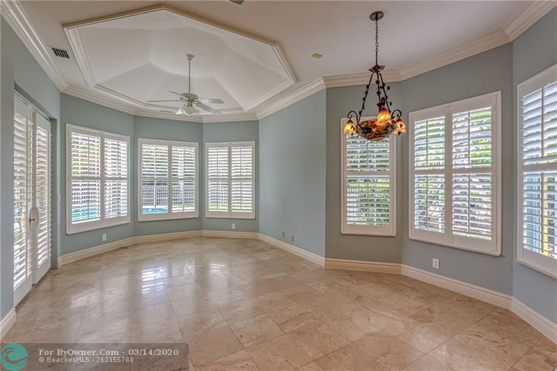 Spacious breakfast area with family room and plantation shutters