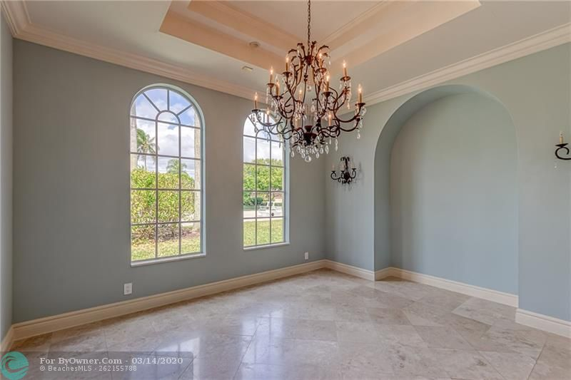 Formal dining room with custom molding and lighting
