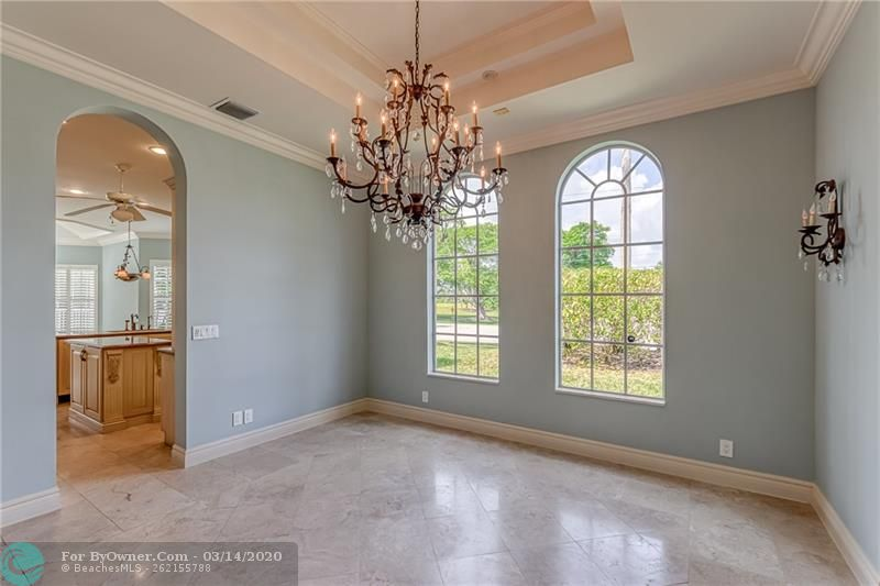 Large formal dining room with natural light