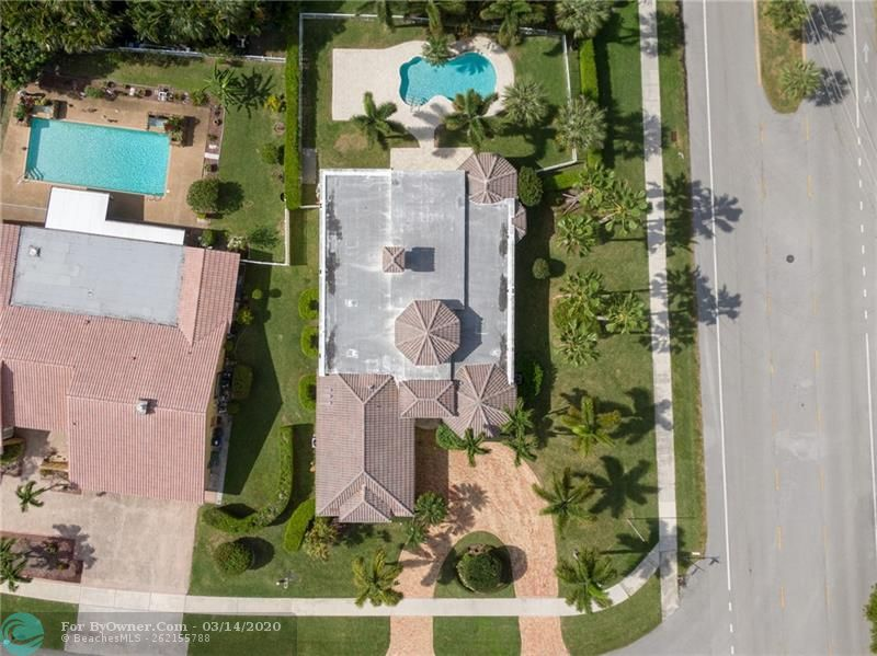Tropical paradise on this large corner lot