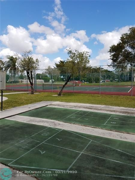 COMMUNITY SHUFFLEBOARD AND TENNIS COURTS