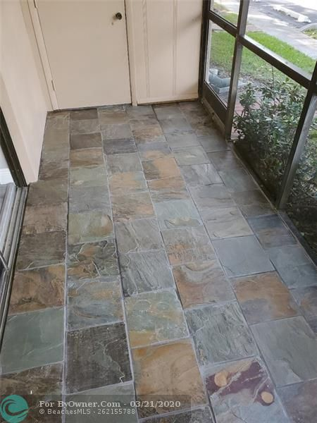 STONE TILE ON SCREENED PATIO