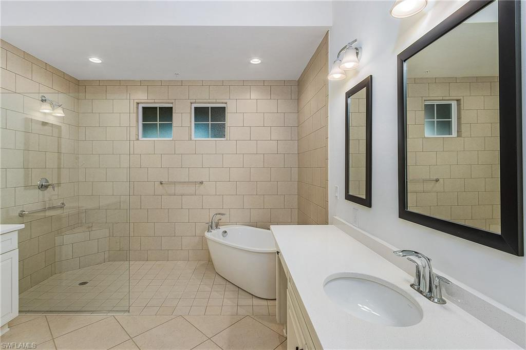 The owner\'s suite features dual vanities, spacious shower, and roman-style tub.