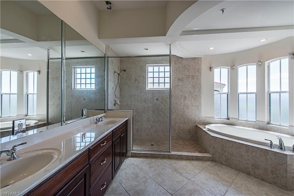 Dual vanities, soaking tub, shower, private commode