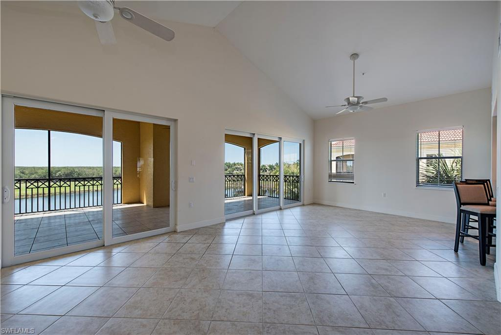 Living/Dining Room overlooks lake and GC diagonal tile