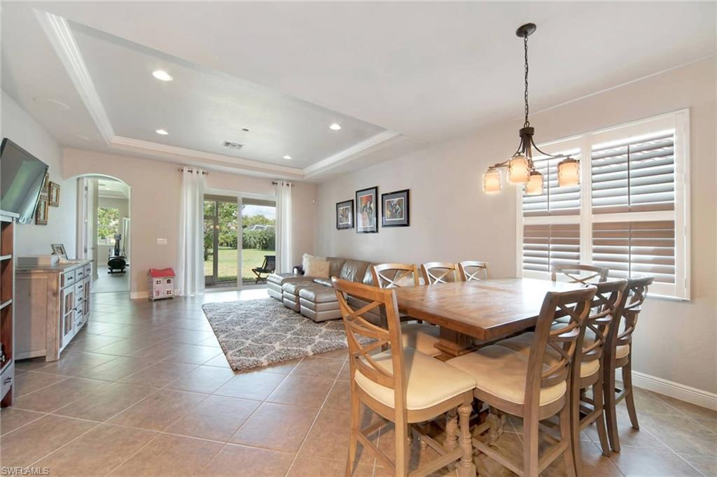Family-Dining Room with tray ceilings, surround sound and plantation shutters