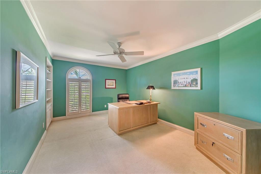 Den with plantation shutters